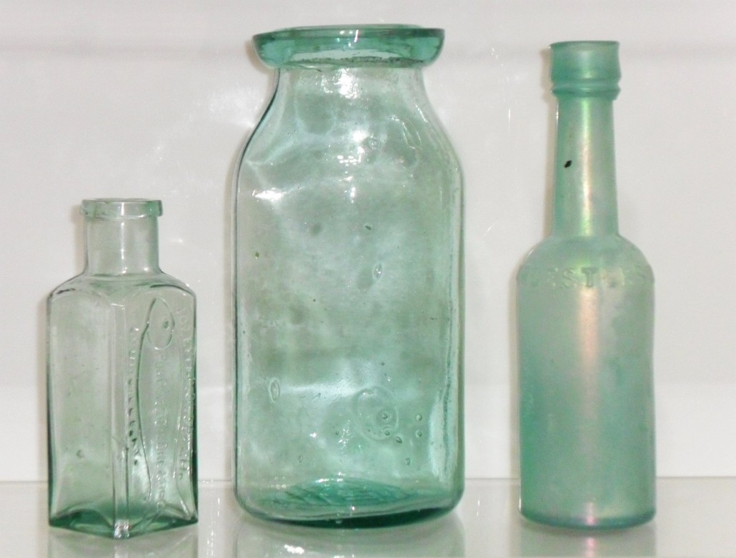 Left to right: JOSEPH GOLDBACH / PORPOISE OIL DRESSING / LOUISVILLE,KY. (shoe/leather dressing); Wax sealer type fruit jar; Worcestershire Sauce bottle, all marked F.C.G.CO. on base.