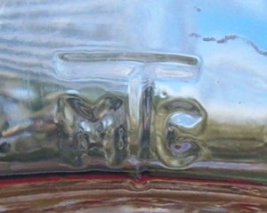 """M T C"" mark on heel of milk bottle. (Photo courtesy of ebay seller Cawhite1946)"