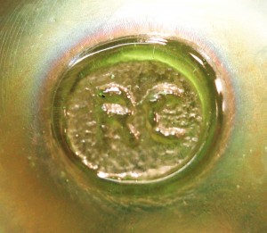 RC inside circle~Robert Coleman. On base of decorative iridescent 2-handled blown bottle. (Photo courtesy Carey Hamilton)