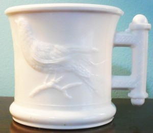 "Eastlake (""Robin"") pattern mug in white milkglass, circa 1880s-1890s. This is the 2-compartment Shaving Mug variant."