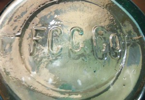 F.C.G.CO. on base of chemical/packer bottle.