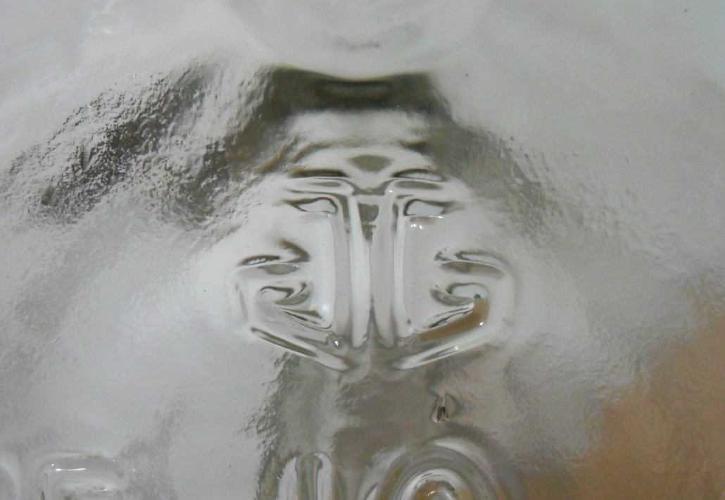 Anchor Glass Container Corporation logo, here as embossed on the base of a Jim Beam handled liquor jug, date coded 2006.