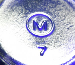 M in a circle bottle base