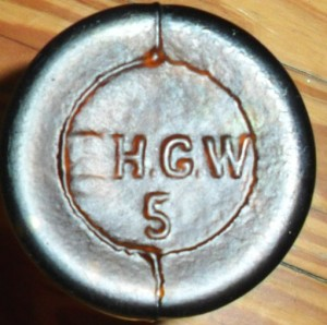 "FHGW mark on base of ""pint"" size beer bottle. The ""F"" is only partially visible on this example."