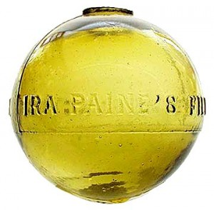"Glass Target Ball, marked ""IRA PAINE'S FILLED BALL  PAT OCT 23 1877"" in yellow amber (photo courtesy Glswrk-auction.com)"