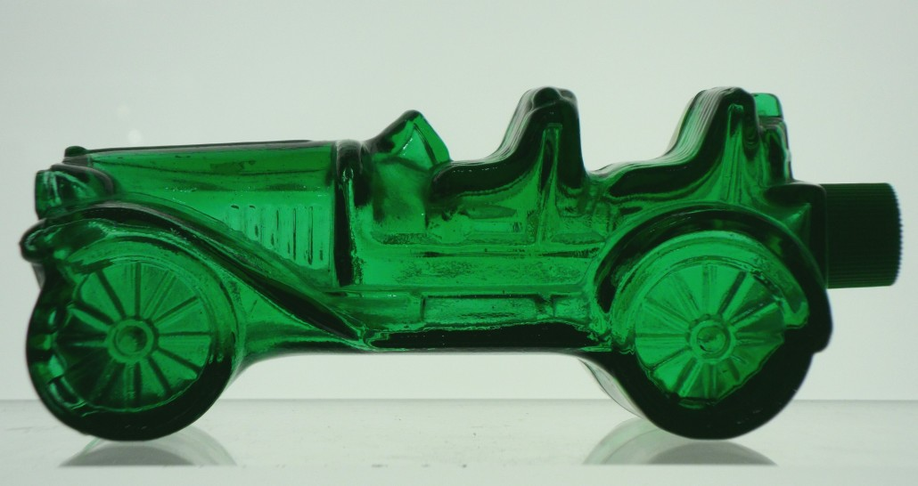Avon car bottle, emerald green. Contained Tai Winds or Wild Country Aftershave, circa 1973.