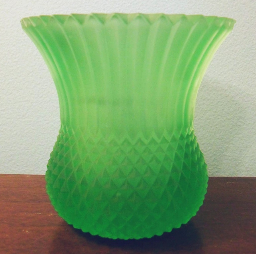 "Bright green FAROY candle cup, pattern similar to ""SAWTOOTH""."