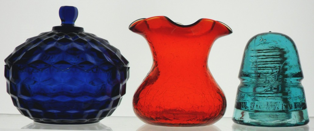 "Cobalt Blue candy dish (Indiana Glass Company);  Red ""Crackle glass"" vase (Rainbow Glass Company); Aqua Telegraph line Insulator (Brookfield Glass Company)"