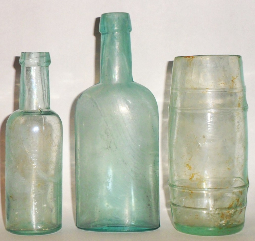 Great Western Glass Company bottles (left to right, round castor oil; oval bluing; mustard barrel).