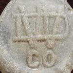 WDCO monogram, as it appears on beach glass (bottle base). Photo courtesy of Natalie Radosevic.