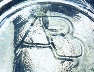 AB-connected mark on beer bottle