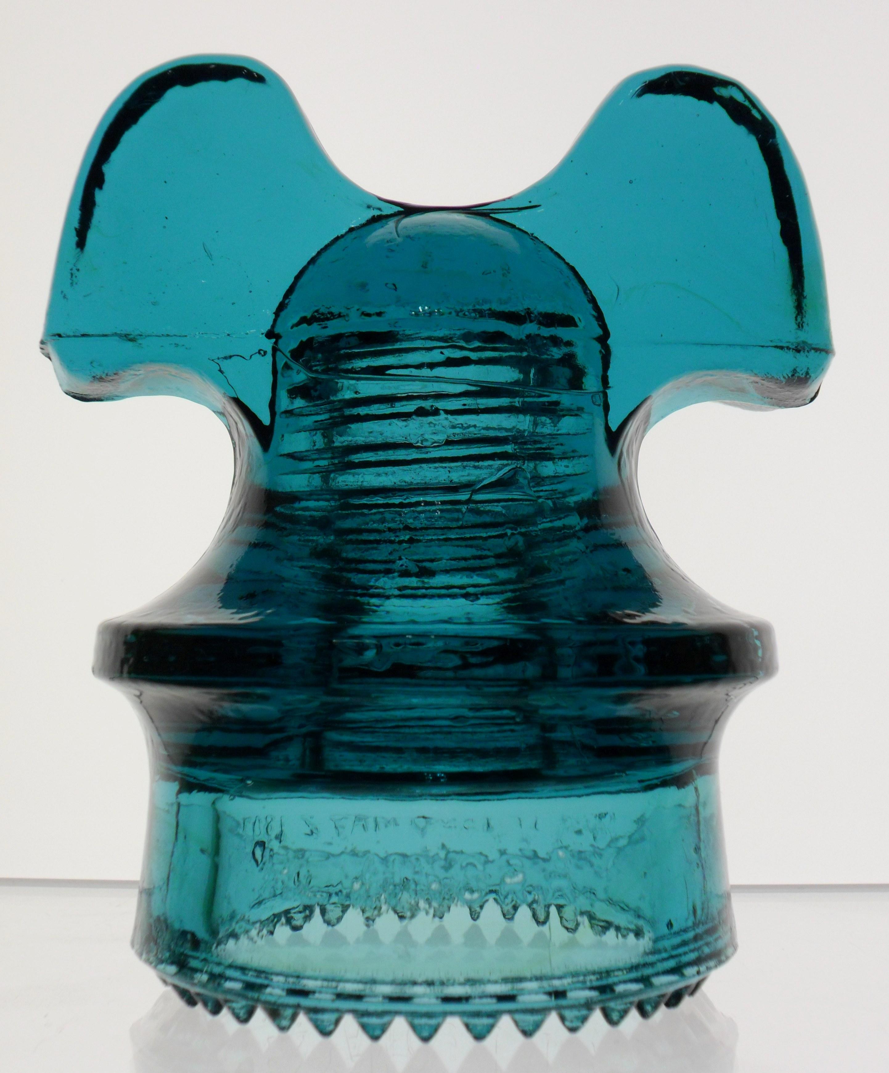 "Blue Aqua or ""Hemingray Blue"" CD 257 ""Mickey Mouse"" style glass insulator."