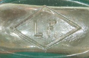 "LF in a diamond - on base of tooled-lip ""Strapside"" flask. (Picture courtesy of Jimmy Bray)"