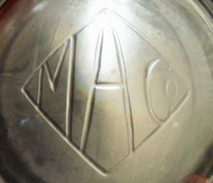 M A Co in diamond (on base of clear glass shaving mug)