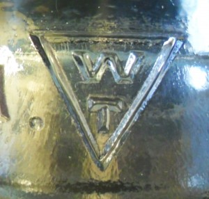 WT in Triangle mark, as embossed on glass insulator.