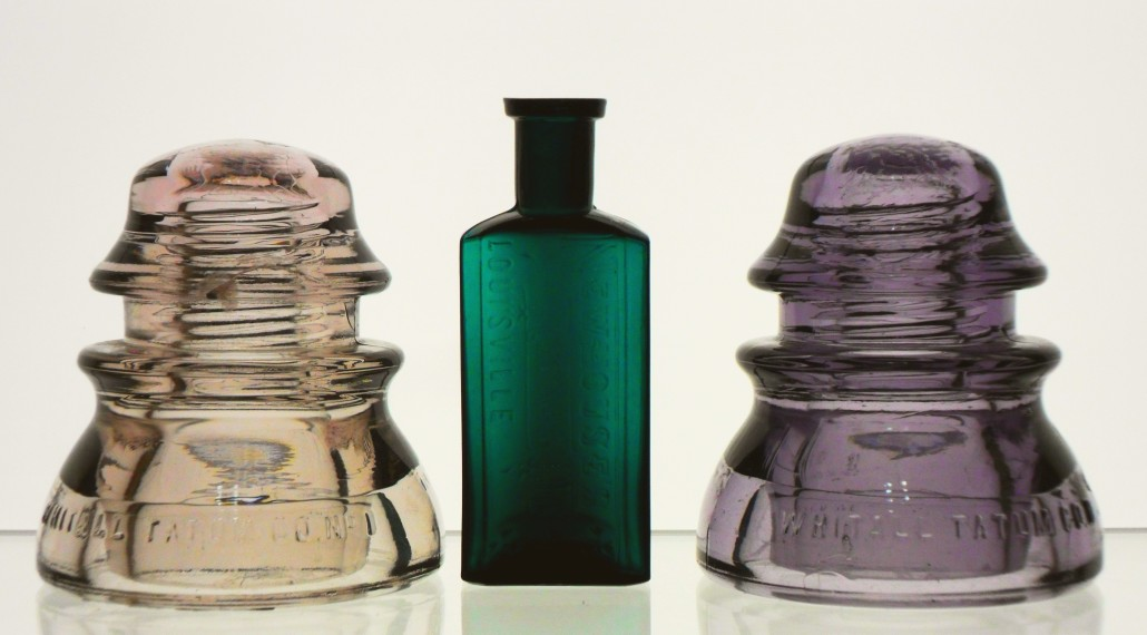 Whitall Tatum Druggist bottle in treal green,  and 2 CD 154 glass insulators, in purple and peach