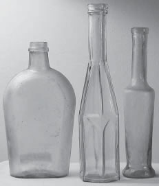 Group of three Falls City Glass Company bottles