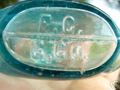 Base of F.C.G.Co. (Falls City Glass Company) pumpkinseed whiskey flask