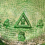 R in a triangle mark used by Reed. This bottle base has 1949 date code to right.