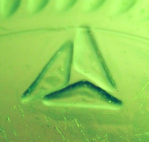 American National Can Company mark, triangle / sailboat-like logo