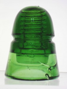 "Green Brookfield-made ""beehive style"" CD 145 insulator, marked ""B""."