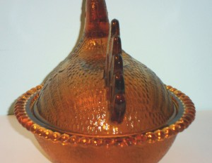 Indiana Glass Company hen in amber, tail view