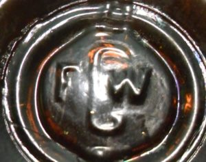 FGW mark on the base of small cylindrical utility bottle