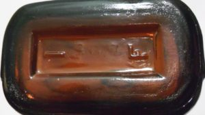 """F"" mark on the base of screw-lip-style Wintersmith bottle"