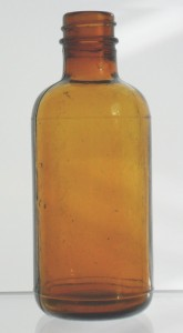 "Typical ""generic"" amber ""packer"" bottle made by Illinois Glass Company, marked with ""Diamond I"" on base."