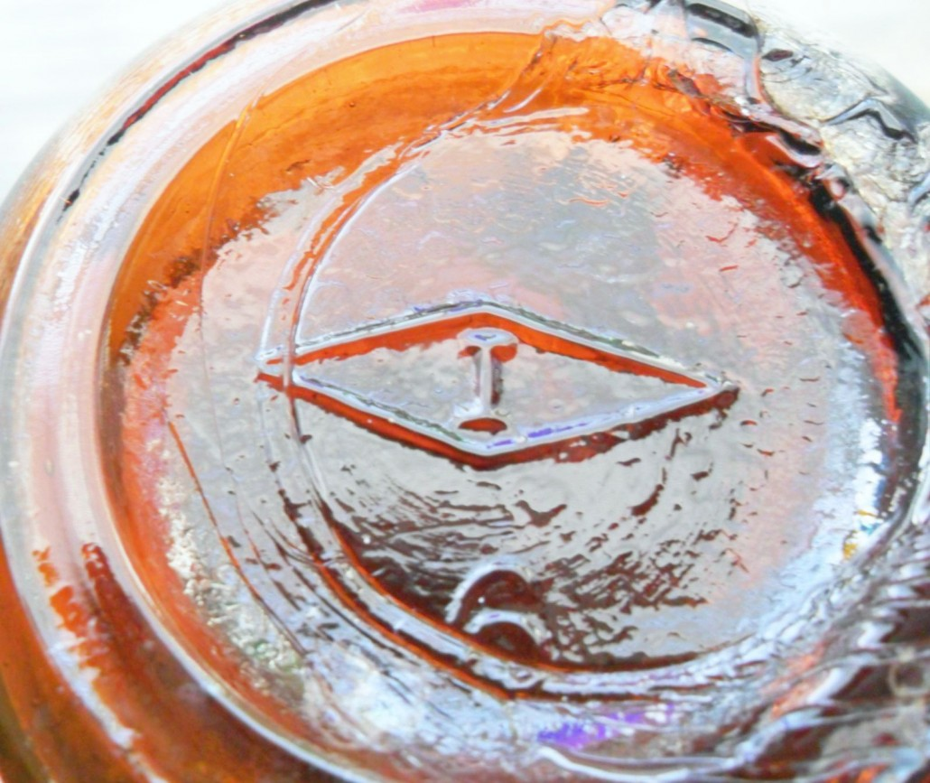 Mark on bottom of amber bottle made by Illinois Glass Company.