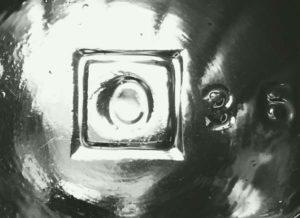 """O in a Square"" mark as seen on the base of a 1920s ketchup bottle."