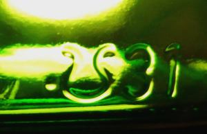 "Ardagh Group. This example on a Heineken bottle has the number ""31"" to the right which denotes glass plant in Moerdijk, Netherlands."