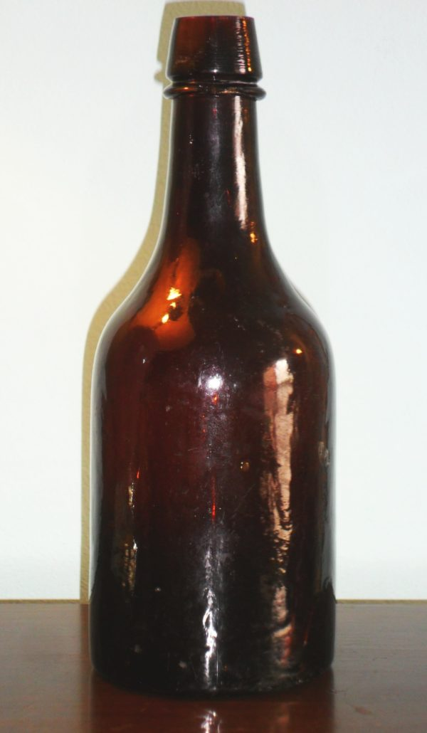 Amber ale bottle made by New Albany Glass Works