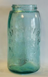 """""""MASON'S PATENT NOV 30TH 1858"""" style fruit jar with """"WCD / 81"""" on the base."""